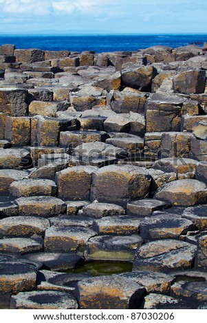 Giantâ??s Causeway located in County Antrim on the northeast coast of Northern Ireland - stock photo