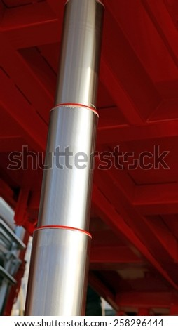 giant stainless steel Hydraulic cylinder below the caisson tipper truck in the yard - stock photo