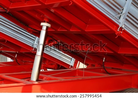 giant stainless steel piston below the truck in the site - stock photo