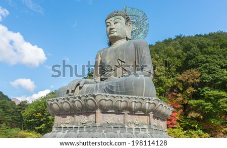 Giant statue of Buddha in the Sinheungsa Temple in Seoraksan National Park, South korea  - stock photo