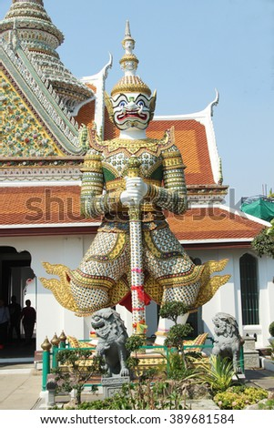 Giant statue of Wat Arun temple, Bangkok city in Thailand.