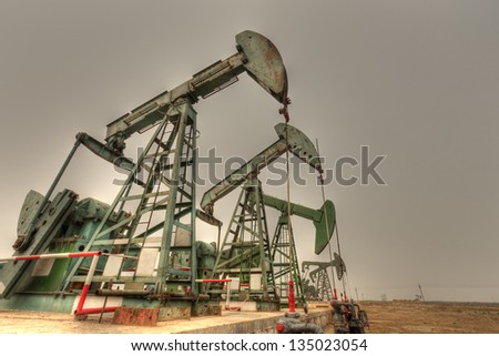 Giant steel oil pumps (HDR) - stock photo