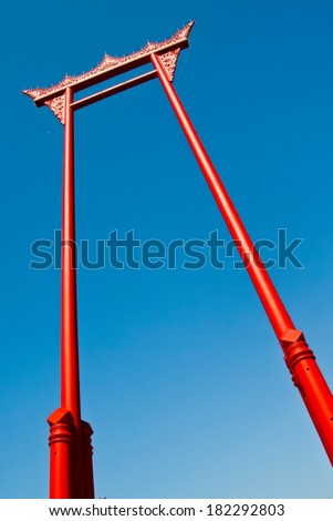 Giant swing with cloudy blue sky, the landmark of bangkok, thailand