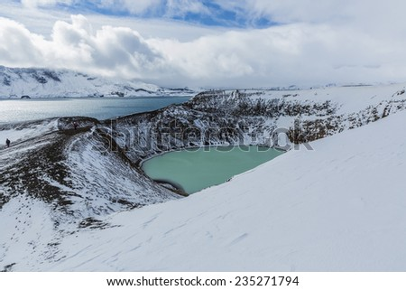 Giant volcano Askja offers a view at two crater lakes. The smaller, turquoise one is called Viti and contains warm geothermal water and is good for swimming. - stock photo