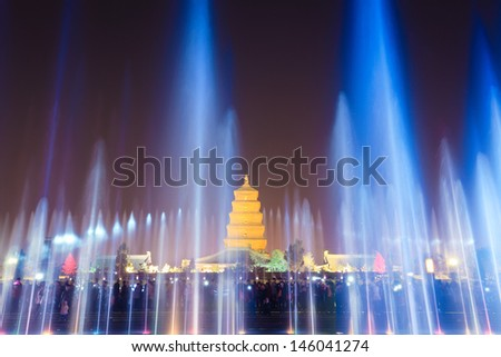 giant wild goose pagoda in Xi'an at night with fountains,China - stock photo