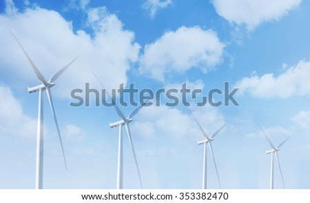Giant wind turbines and clouds - stock photo