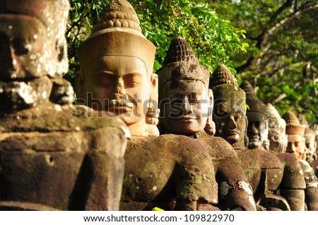 Giants in Front Gate of Angkor Thom - stock photo