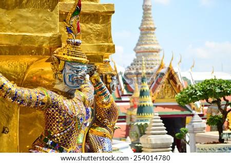 Giants under golden pagoda in wat pra keaw , Bangkok , Thailand - stock photo