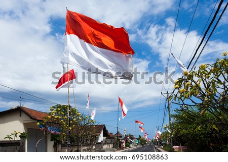 GIANYAR, BALI, INDONESIA, CIRCA AUGUST 2016 -  Residents of Sukawati Village, Bali, raised the national flag during August to commemorate the Independence Day of the Republic of Indonesia