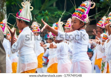 GIANYAR, INDONESIA - OCTOBER 11, 2011: Unidentified children dance legong during Full Moon Holiday in Tirta Empul Temple in Gianyar. - stock photo