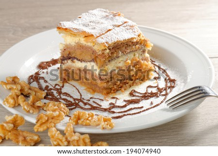 Gibanica - traditional slovene cake pie, filled with walnuts, poppy, cottage cheese and apples  - stock photo
