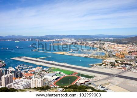 Gibraltar airport runway and La Linea de la Concepcion in Spain, southern Andalucia region, Cadiz province. - stock photo