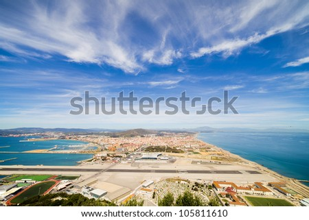 Gibraltar airport runway, La Linea de la Concepcion town in Spain at the far end, Mediterranean Sea on the right, Gibraltar Bay on the left. - stock photo
