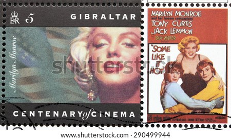GIBRALTAR - CIRCA 1995. A postage stamp printed by GIBRALTAR shows American actress Marilyn Monroe, actors Jack Lemmon and Tony Curtis starring in the film Some Like It Hot, circa 1995. - stock photo