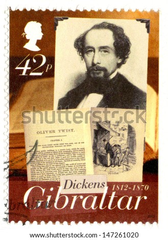 GIBRALTAR - CIRCA 2005 : A stamp printed in Gibraltar shows Charles Dickens (1812-1870), Oliver Twist, 200th anniversary of Charles Dickens, circa 2005 - stock photo