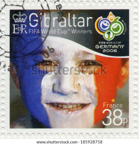 GIBRALTAR - CIRCA 2006 : A stamp printed in Gibraltar shows child with face painted as flag of France, devoted 2006 World Cup Soccer Championships, Germany, circa 2006 - stock photo