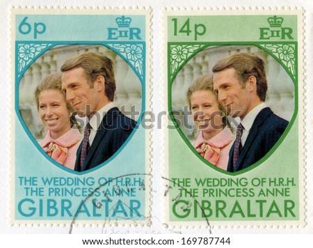 GIBRALTAR - CIRCA 1973: A vintage postage stamp from Gibraltar celebrating the Royal Wedding of Princess Anne & Captain Mark Phillips, circa 1973. - stock photo