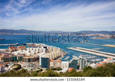 Gibraltar city and bay from above, Spain on the horizon. - stock photo