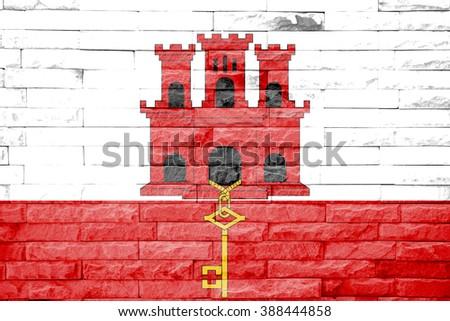 gibraltar flag a brick wall background - stock photo