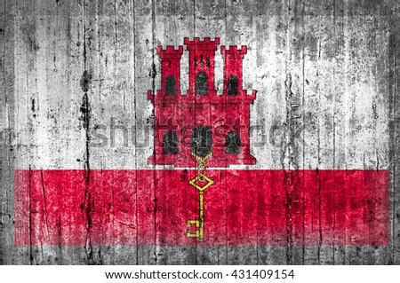 Gibraltar flag on concrete wall  - stock photo