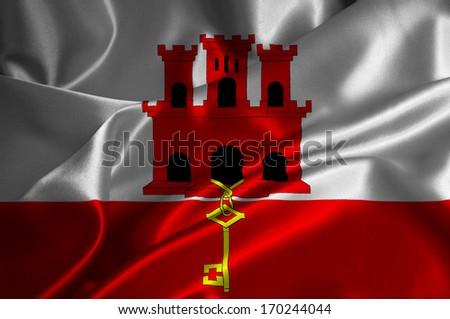 Gibraltar flag on satin texture. - stock photo