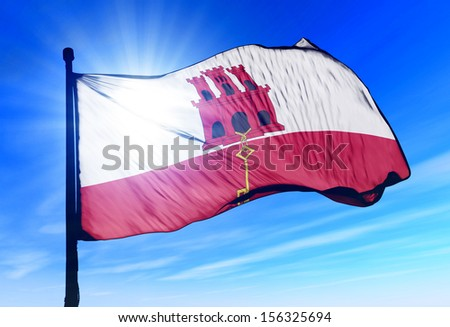 Gibraltar flag waving on the wind - stock photo