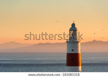 Gibraltar Lighthouse at Sunset - stock photo