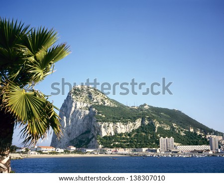 Gibraltar on a sunny day seen from across the bay - stock photo