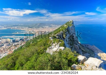 Gibraltar Rock view from above, on the left Gibraltar town and bay, La Linea town in Spain at the far end, Mediterranean Sea on the right. - stock photo