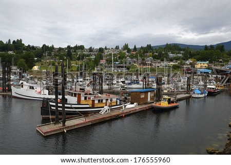 Gibsons Harbor Marina, British Columbia. Gibsons Harbor marina on a gray day with the town of Gibsons in the background. British Columbia, Canada.  - stock photo