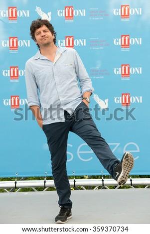 GIFFONI VALLE PIANA (SA) - JULY 18: Actor Fabio De Luigi poses at photocall during the 45th Giffoni Film Festival at Cittadella del Cinema, July 18, 2015 in Salerno, Italy. - stock photo