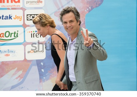 GIFFONI VALLE PIANA (SA) - JULY 18: Actor Mark Ruffalo and wife Sunrise Coigney poses at photocall during the 45th Giffoni Film Festival at Cittadella del Cinema, July 18, 2015 in Salerno, Italy. - stock photo