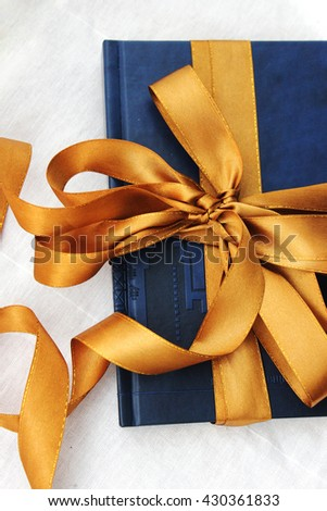 gift: a book with Golden bow