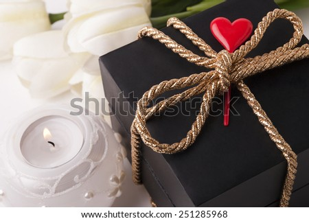 Gift and candle - stock photo