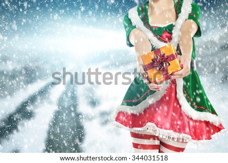 gift and elf on road of winter time  - stock photo