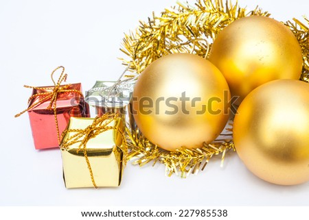 gift and golden ball on white background