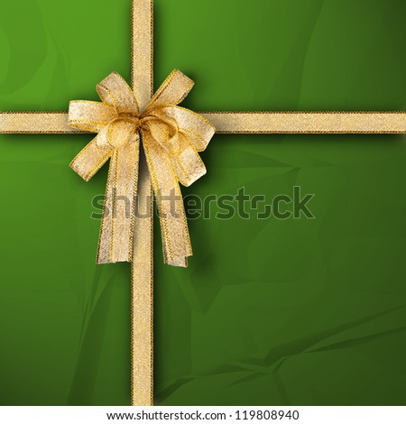 Gift and present wrapping box with gold ribbon and green paper - stock photo