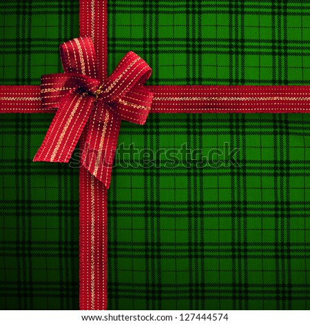 Gift and present wrapping box with red hot ribbon and hatch pattern paper - stock photo