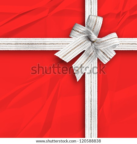 Gift and present wrapping box with snow white ribbon and red paper - stock photo