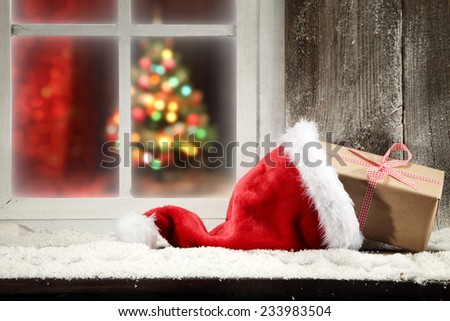 gift and santa clause hat  - stock photo