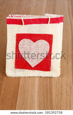 Gift bag on wooden background - stock photo