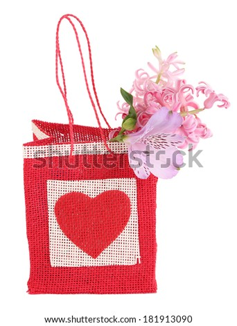 Gift bag with flowers isolated on white - stock photo