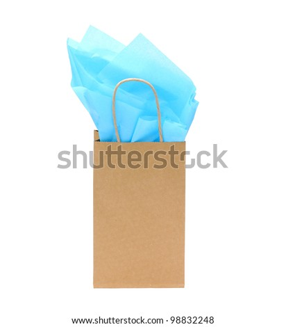 gift bag with tissue paper isolated on white background - stock photo