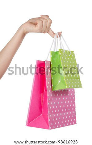 Gift bags in hand isolated on white