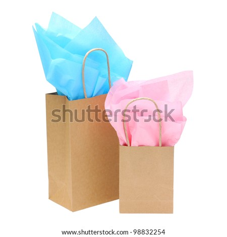 gift bags with tissue paper isolated on white background - stock photo