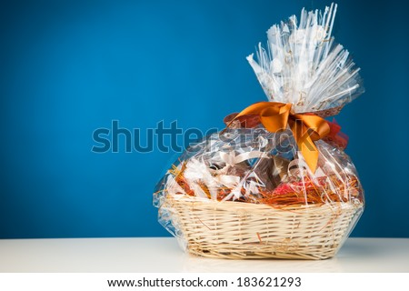 Gift basket gift basket against blue background negle Choice Image