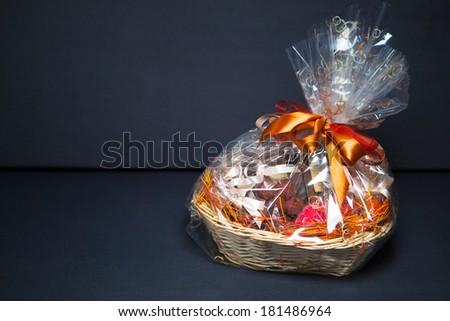 gift basket against grey background - stock photo