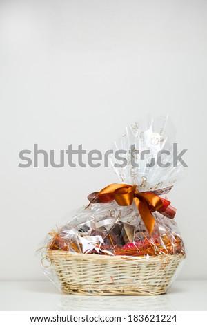 gift basket against light beige background - stock photo