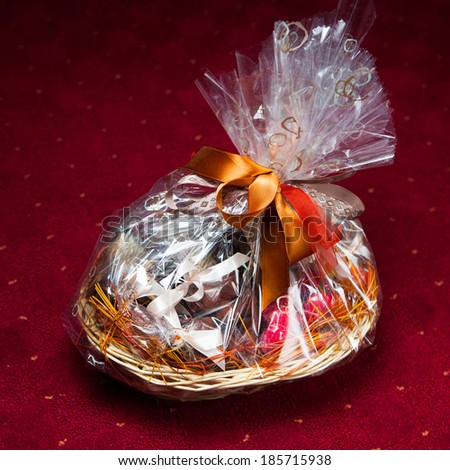 gift basket against red background - stock photo