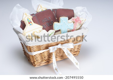 Gift basket of Christian cookie shapes: cross, dove, bible, and church. Shot with copy space. - stock photo